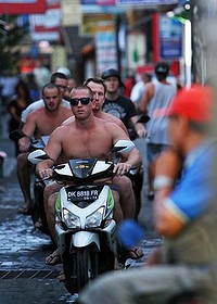 Guys on motorbikes, clothing and helmets optional