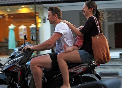 Tourist family on motorbike in Bali