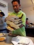 Balancing Plates in a Padang Restaurant